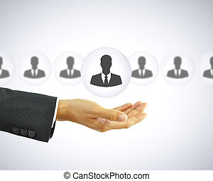 Hand holding businessman icon - HR concept - Hand holding...
