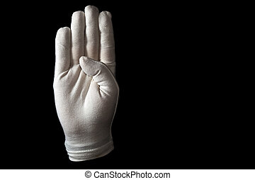 Sign language - A white gloved hand isolated on black...