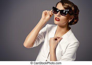 retro glasses - Close-up portrait of a gorgeous young woman...