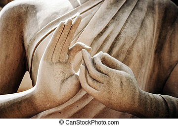close up buddha statue hand