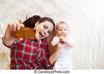Little baby girl and her mother - Cute little baby girl and...