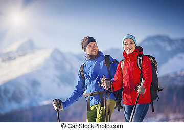 Couple hiking outside in winter nature