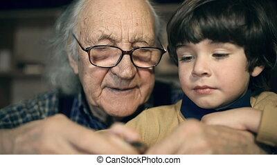Under Guidance - Macro shot of little boy repairing watch...