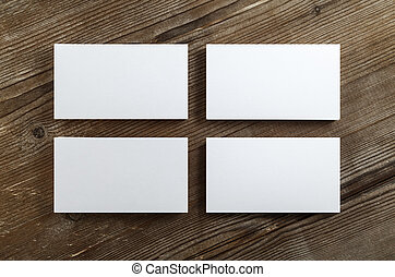 Photo of business cards - Four stacks of blank business...