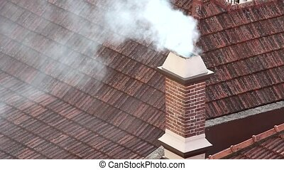 Chimney chalet - Smoke coming from chimney to the sky in...