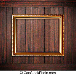 Golden picture frame on wooden wall - Golden picture frame...