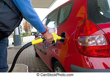woman at the gas station to refuel