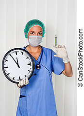 surgical nurse - a nurse or doctor in surgical clothing...