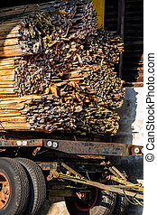 stacked bars on a trailer, symbol of construction, building...