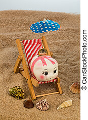 beach chair with piggy bank and euro - beach chair with euro...