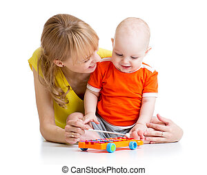 smiling child and mom playing with musical toy - smiling...