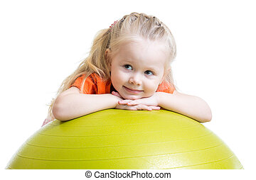 child girl doing fitness exercise with ball