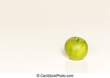 an apple on a white background - green apple lying on a...