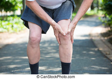 Knee pain - Closeup cropped portrait, older man in white...