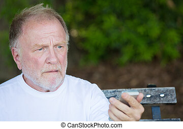 Old man shocked at cell phone message - Closeup portrait of...
