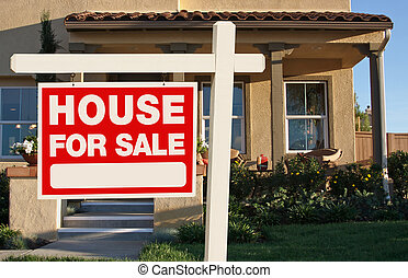 Home For Sale Sign and New Home - Home For Sale Sign in...