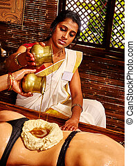 Woman having Ayurvedic spa treatment - Young woman having...