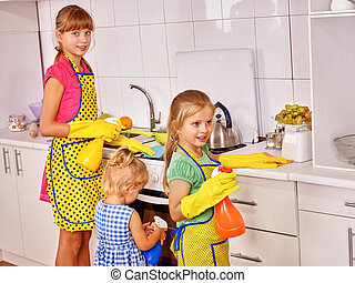 Children cooking at kitchen - Children little girl cooking...