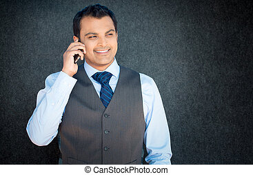 Happy discussion on phone - Closeup portrait, handsome young...