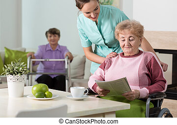 Old women and a nurse taking care of them