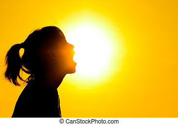 Silhouette girl open her mouth with sun rise. - Silhouette...