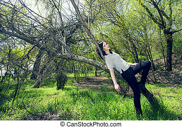 young woman lying on a tree