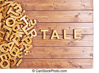 Word tale made with wooden letters - Word tale made with...