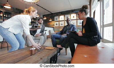 Business people in a cafe discussin - Business people...