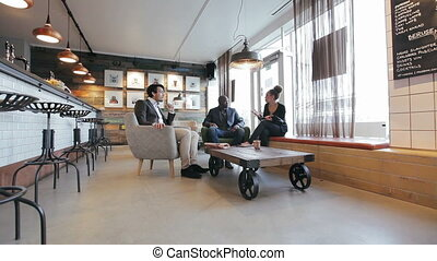 Business people in a cafe discussin