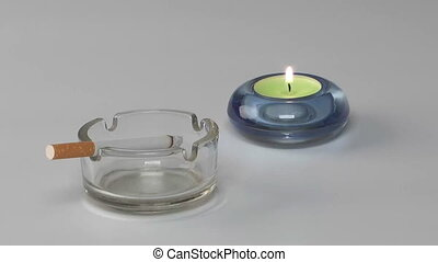 Cigarette and candle - Smouldering cigarette in a...