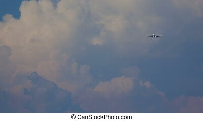 Final approach - Jet airplane approaching in dusk, telephoto...