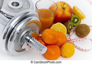 Fitness equipment and healthy food, apple, nectarines, kiwi,...