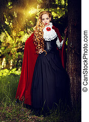 deep forest - Beautiful blonde woman in old-fashioned dress...