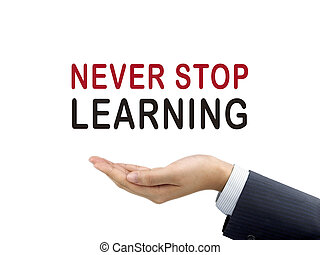 never stop learning words holding by businessman's hand over...