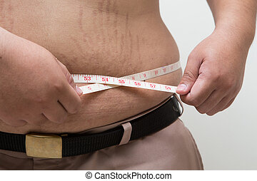 Fat man holding a measuring tape