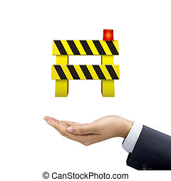 businessman's hand holding road barrier over white...