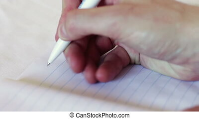 Man writes a pen in a notebook The phrase I love you - Man...