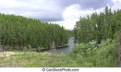 (Seamless Loop) Northwoods Fishing - A top of hill view of a...