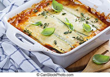 Healthy zucchini lasagna bolognese in a baking dish