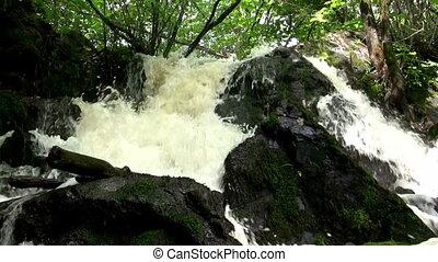 (Seamless Loop) Overflowing - Overflowing waterfall shot...
