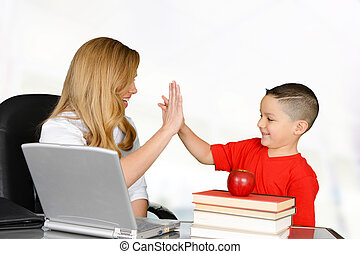 High five - Student and teacher high five in class
