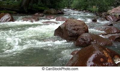 (Seamless Loop) Flowing Water Over
