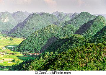 Mountain peaks - Aerial view of multiple mountain peaks in...