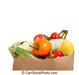 Paper grocery sack with vegetables on white