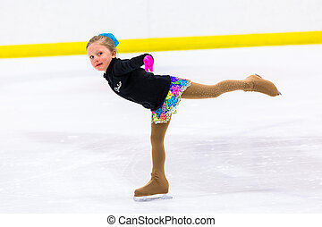 Figure skating - Young figure skater practicing at indoor...