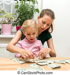 concept: to save money for the future - woman and little...