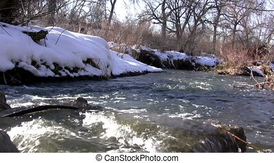 Seamless Loop Loop Seamless - The snowmelt overflows the...