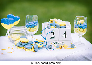 macaroon blue yellow - Sweets on a plate that is on the...