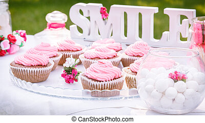 pink cakes - Sweets on a plate that is on the table on a...