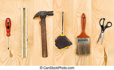 tools hanging on the wooden background
